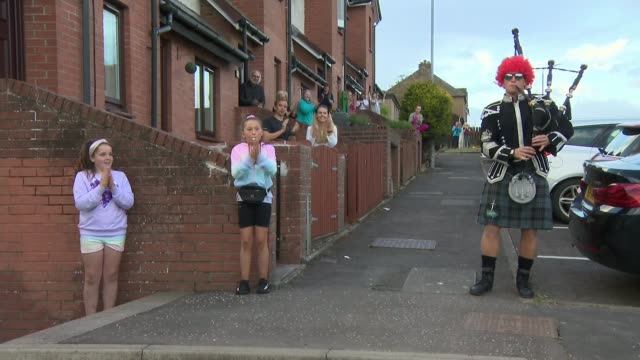 people take to streets to clap for the glasgow scotland glasgow ext bagpiper wearing red curly wig waiting for the start of the latest clap for... - curly stock videos & royalty-free footage