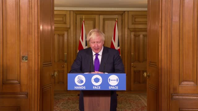 vidéos et rushes de pfizer vaccine approved for rollout in uk from next week; england: london: westminster: downing street: int boris johnson mp press conference sot. -... - invisible