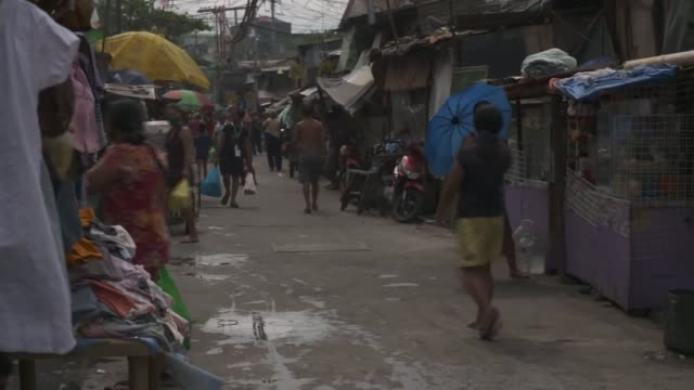 philippines' duterte extends brutal lockdown measures to end of month; philippines: manila: ext gv people wearing masks along busy street in the city... - philippines stock videos & royalty-free footage