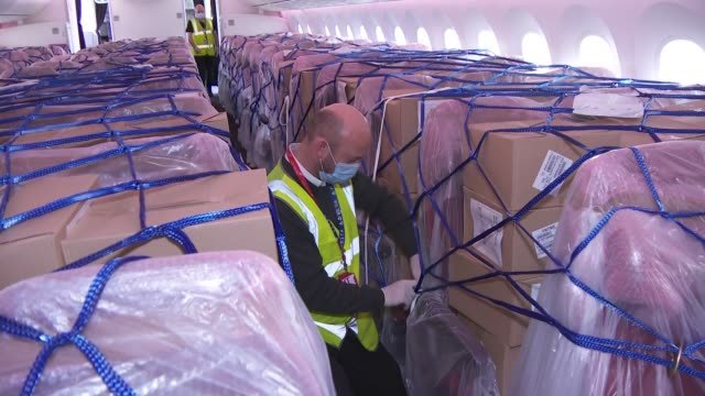 plane carrying ppe shipment from china arriving; england: london: hillingdon: heathrow airport: int plane close of cargo in seats - ppe from china /... - freight transportation stock videos & royalty-free footage