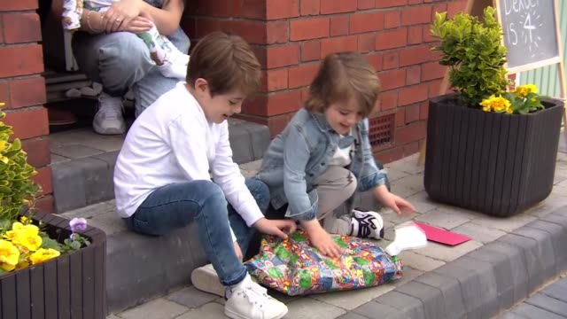 police cheer up boy with lockdown birthday visit; england: liverpool: mossley hill: ext police officer talking to four-year-old dexter lee through... - birthday stock videos & royalty-free footage