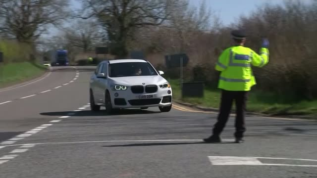 police given new powers to enforce stay at home restrictions location police officers pulling over car at checkpoint to see that the driver is... - looking stock videos & royalty-free footage