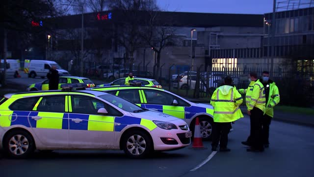 police investigate suspicious package sent to astrazeneca vaccine processing plant in wrexham; wales: wrexham: ext / dusk various shots of police and... - sending stock videos & royalty-free footage