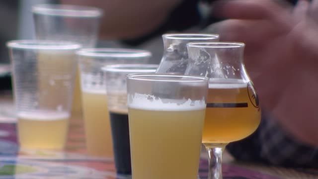 police urge people not to party this weekend ahead of new rules limiting social gatherings; england: bristol: ext various shots of people seated at... - alcohol drink stock videos & royalty-free footage