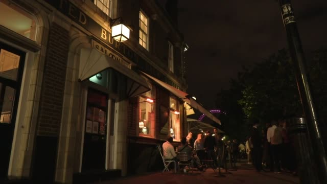 police urge people not to party this weekend ahead of new rules limiting social gatherings england london soho down corner of old compton street and... - tilt down stock videos & royalty-free footage