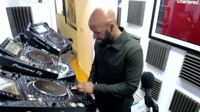 dj spoony hosts online music sessions to raise money for the nhs england spoony speaking to camera and playing records sot - musician stock videos & royalty-free footage