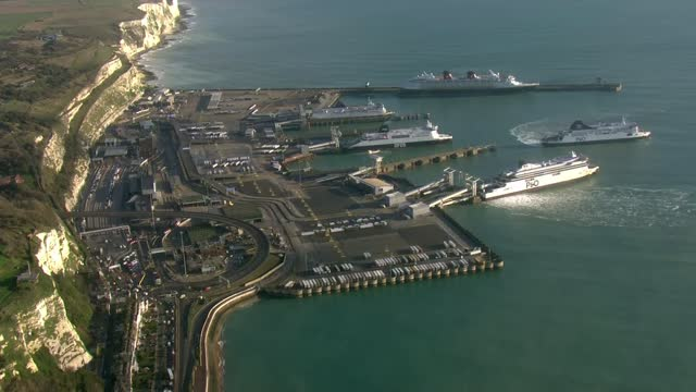 port of dover and manston lorry park aerials; england: kent: air views / aerials port of dover / residential streets with traffic backlog / dover... - infectious disease stock videos & royalty-free footage