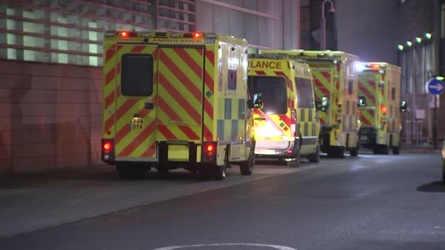 pressure mounts on government to delay school re-opening; england: london: ext at night ambulance pulling up in road outside the emergency department... - emergencies and disasters stock videos & royalty-free footage