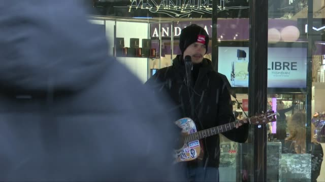 stockvideo's en b-roll-footage met pressure rising on sweden to follow stricter approach to containment sweden stockholm gv man playing acoustic guitar covered in stickers in snow gv... - politics