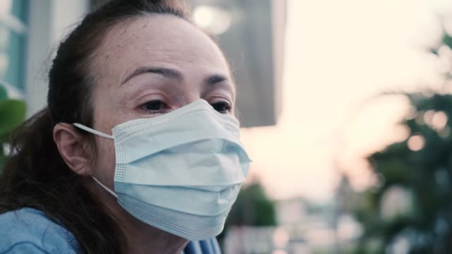coronavirus prevention. woman wearing protective mask. worried expression. - despair stock videos & royalty-free footage