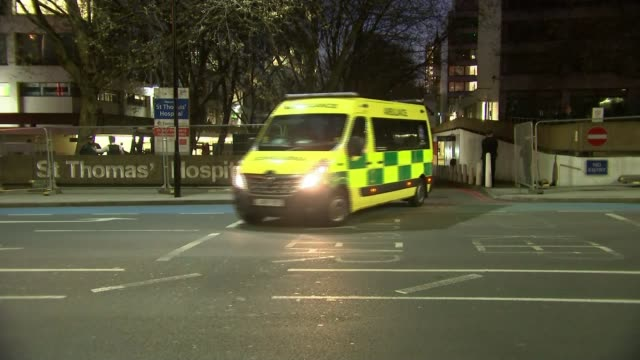 prime minister boris johnson goes into intensive care; england: london: ext at night ambulance driving out from st thomas' hospital, where prime... - prime minister stock videos & royalty-free footage
