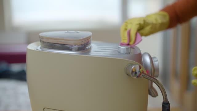 coronavirus protection. cleaning the coffee maker. keep everything clean and disinfected. hygiene importance. - washing up glove stock videos & royalty-free footage
