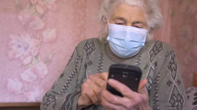 coronavirus protection. senior woman wearing mask to avoid infectious diseases. - senior women stock videos & royalty-free footage