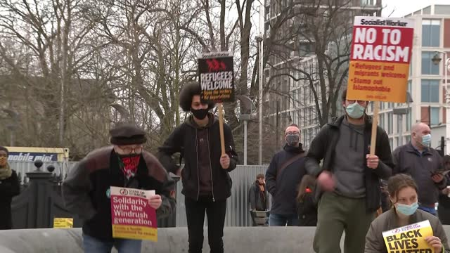 protesters and police clash at anti-lockdown demonstration; england: london: ext gv police along as restraining man and man kicking officer rear view... - square stock videos & royalty-free footage