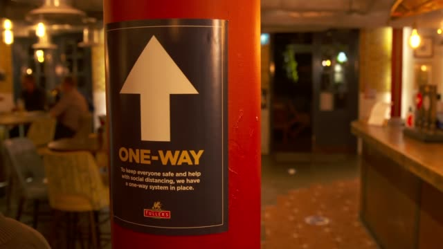 pub interiors at 10pm; england: int 'one way' sign on pillar in pub - column stock videos & royalty-free footage