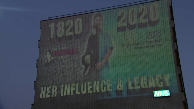 public asked to shine a light from their windows to celebrate 200th anniversary of florence nightingale's birth england london billboard advertising... - shiny stock videos & royalty-free footage
