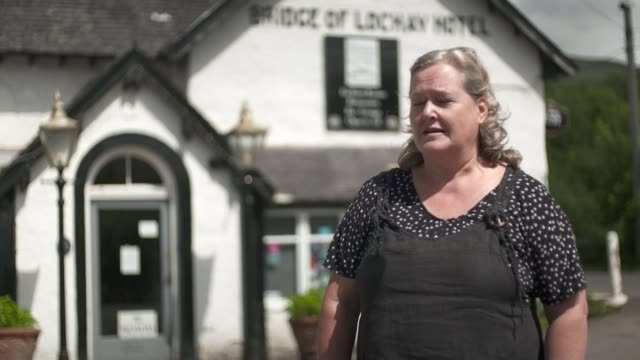 pubs and cafes allowed customers outside amid tentative easing of restrictions; scotland: southern highlands: ext highland landscape and parcel force... - meal stock videos & royalty-free footage