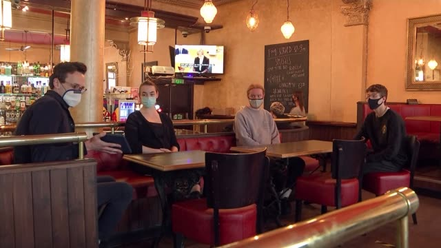 pubs and restaurants in scotland central belt to close for a fortnight; scotland: glasgow: ext reporter to camera max's bar: int barman pulling pint... - lager stock videos & royalty-free footage