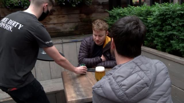 pubs, hotels and restaurants reopen in northern ireland; northern ireland: belfast: the dirty onion pub: ext customers entering courtyard of pub and... - belfast stock videos & royalty-free footage