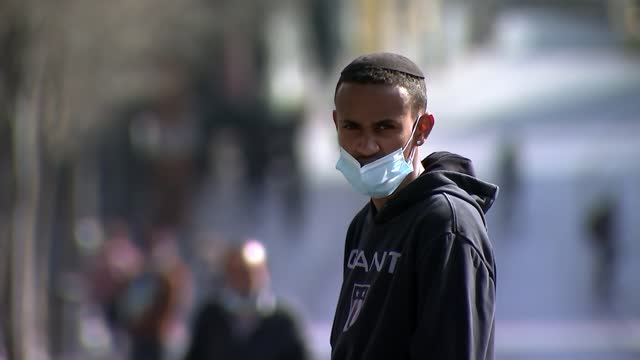 quarter of israelis have already received first vaccine dose; israel: jerusalem: old city: gv people towards in street gv boy in street wearing mask - politics stock videos & royalty-free footage