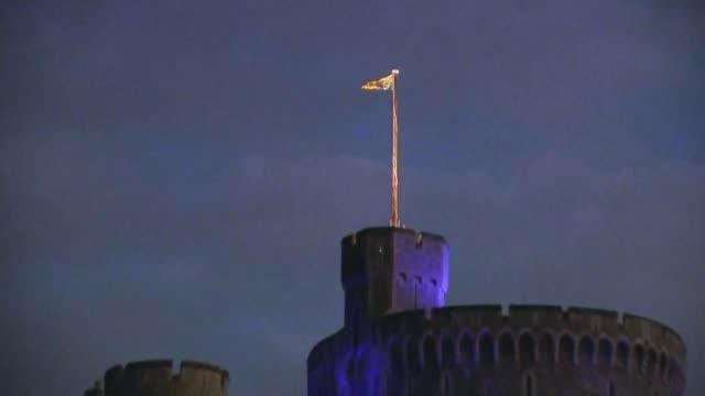 queen elizabeth to address nation / prince charles opens nightingale hospital london; 2.4.2020 england: berkshire: windsor: ext / dusk windsor castle... - illuminated stock videos & royalty-free footage