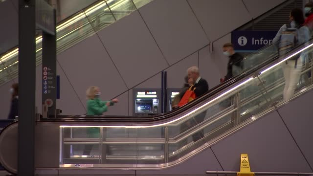 "gvs london bridge station; england: london: southwark: london bridge station: int passenger through railway station concourse / various sign ""wear a... - walking stock videos & royalty-free footage"