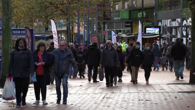 reading town centre shoppers; england: berkshire: reading: ext various of shoppers, many wearing face masks, along busy pedestrianised shopping... - shopping stock videos & royalty-free footage