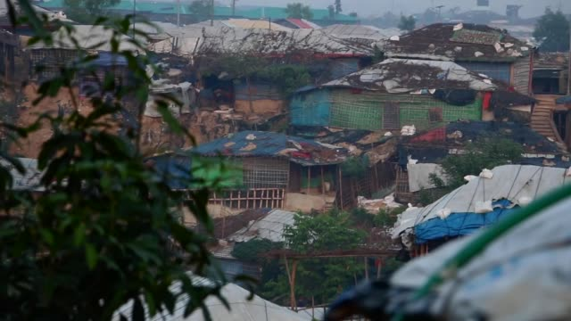 relief agencies fear coronavirus spread in rohingya camps; bangladesh: ext young refugee looking at camera from bamboo shack various wide shots of... - refugee camp stock videos & royalty-free footage