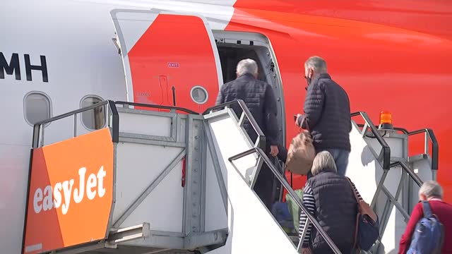 return of foreign travel as lockdown eases; england: west sussex: gatwick airport: ext various of passengers boarding easyjet flight to portugal. - travel stock videos & royalty-free footage