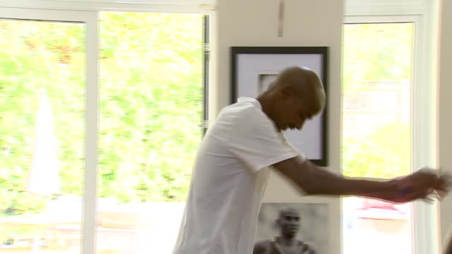 run for heroes 5km sir mo farah interview england surrey int framed mo farah olympic vests and running shoes on wall of house / various of sir mo... - exercise machine stock videos & royalty-free footage