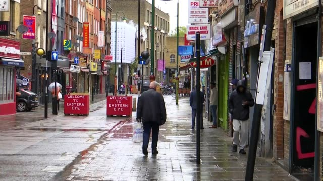 sadiq khan calls for greater restrictions in london england london brick lane ext people along - itv london tonight stock videos & royalty-free footage