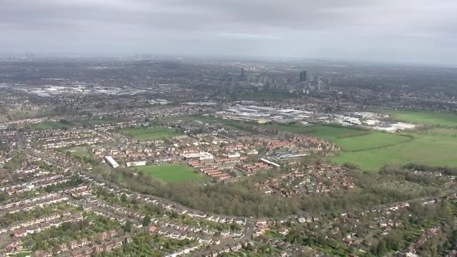 schools to shut from friday as uk coronavirus deaths reach 100; england: london: ext air view london suburbs aerial city of london skyscrapers and st... - suburban stock videos & royalty-free footage