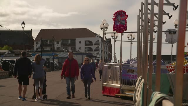 scotland reports highest number of new cases since outbreak began scotland north ayrshire largs ext gv people along promenade vox pop cutaways... - tilt down stock videos & royalty-free footage