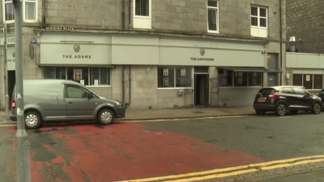 scottish government imposes local lockdown in aberdeen; scotland: aberdeen: ext doors of pub closing man closing outdoor marquee colin cameron... - aberdeen schottland stock-videos und b-roll-filmmaterial