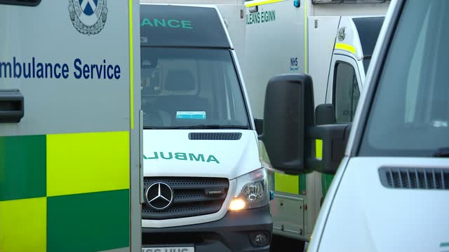 scottish government requests army support to tackle ambulance waiting times; scotland: ext ambulance along motorway with blue lights flashing siren... - politics stock videos & royalty-free footage
