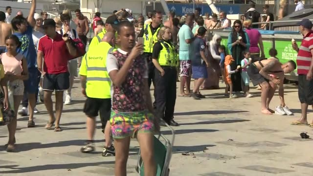 'second spike' concerns as crowds flock to beaches on hottest day of the year; england: dorset: bournemouth: ext beach very busy with people sitting... - standing stock videos & royalty-free footage