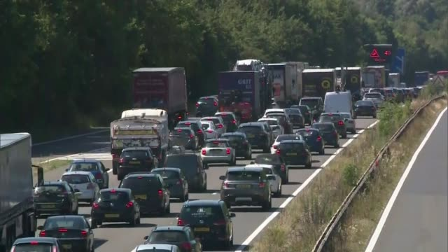 'second spike' concerns as crowds flock to beaches on hottest day of the year; england: hampshire: ext traffic jam on busy m3 motoway - traffic jam stock videos & royalty-free footage