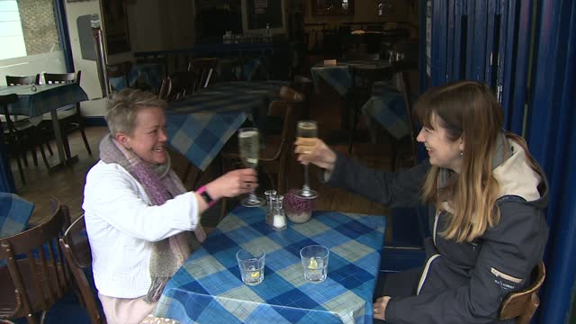 seven in 10 adults in england now have covid-19 antibodies; england: london: islington: ext various of people drinking in seating area outside pubs,... - restaurant stock videos & royalty-free footage