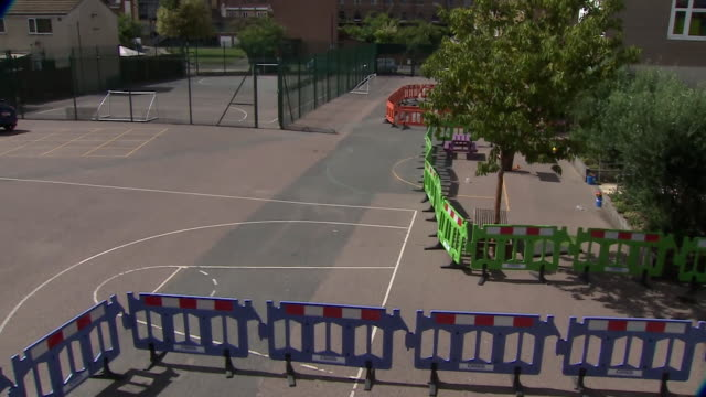coronavirus social distancing signs and measures around uk school buildings - playground stock videos & royalty-free footage