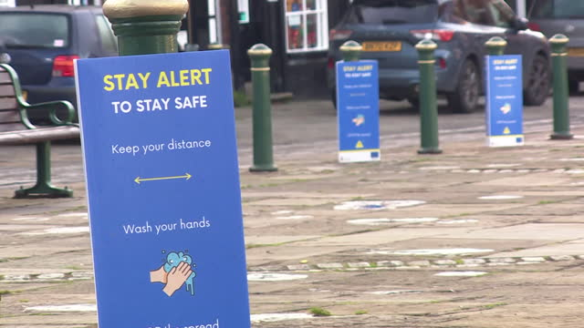 coronavirus social distancing signs in atherstone, warwickshire, as the area goes into tier three restriction - geographical locations stock videos & royalty-free footage