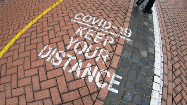 coronavirus social distancing signs on pavement in birmingham city centre - pavement stock videos & royalty-free footage