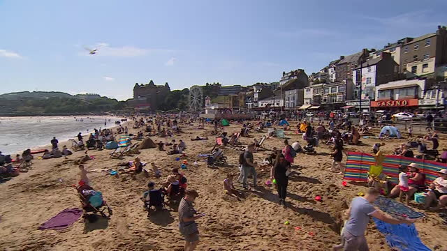coronavirus social distancing warning sign on a beach in scarborough - relaxation stock videos & royalty-free footage