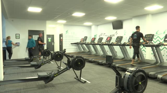 socially distanced gym england london int high angle view gym staff exercising in markedout areas as per social distancing guidelines gv dispenser... - exercise machine stock videos & royalty-free footage
