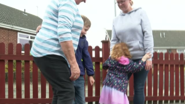 some families meet again as lockdown restrictions eased; england: ext ben and lucy hugging their grandmother connie evans as the government's plans... - embracing stock videos & royalty-free footage