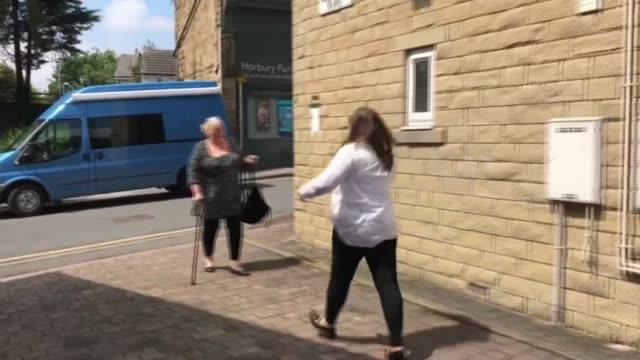 some families meet again as lockdown restrictions eased; england: west yorkshire: leeds: ext ben and lucy crossing road with alison turton and... - embracing stock videos & royalty-free footage