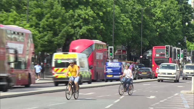 speculation around lockdown 'reopening' on june 21st; england: oxford: ext sir john bell interview sot cutaway bell and reporter london: gv 38 bus... - cycling stock videos & royalty-free footage