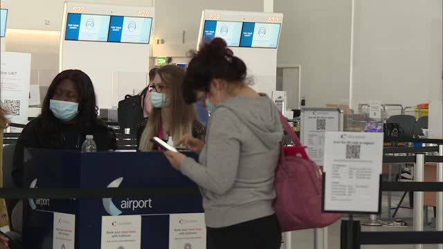 stansted airport gvs; england: essex: stansted airport: int airport general views of people arriving from international arrivals gate wide shots of... - zoom out stock videos & royalty-free footage
