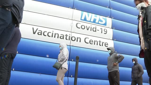 study finds second vaccination jab hugely increases levels of protection; england: greater manchester: rochdale: ext various of people queueing... - variation stock videos & royalty-free footage