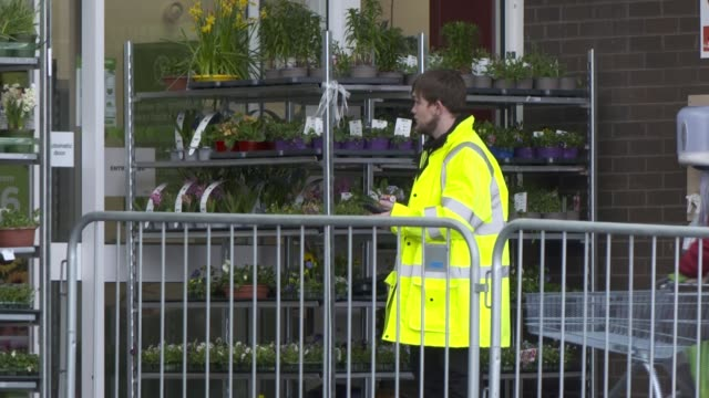 supermarket queue and shop closures in irvine; scotland: north ayrshire: irvine: rivergate mall: ext gvs asda supermarket and people queueing / taxi... - merchandise stock videos & royalty-free footage