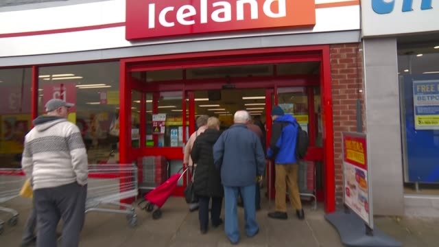 supermarkets implement measures to prevent shortages and protect elderly; england: newcastle: ext gv sign 'iceland' tilt down elderly shoppers along... - iceland stock videos & royalty-free footage